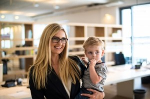 female executive with small child