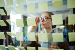 Businesswoman reading memos in office